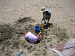 At the beach, digging a second hole...